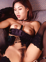 Slender Thai hottie spreads pussy in black stockings