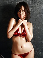 Beautiful gravure idols pink bikini can barely hold her big tits