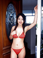 Alluring asian beauty with a perfect body in an orange bikini