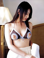 Cute gravure idol taking it all off and showing her perky boobs