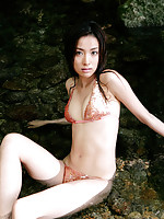 Beautiful asian nymph exhibits her pale ivory skin in a bikini