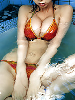 Hot, sultry asian gravure in a bikini with large yummy breasts