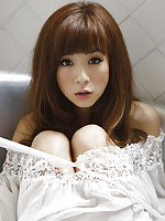 Aki Hoshino sits by the window in her white lingerie and panties