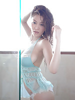 Red headed asian chick with big busty boobs in a blue bikini
