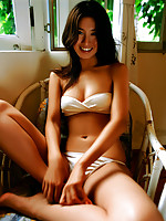 Shapely asian goddes showing her yummy curves in a bikini