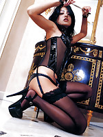 In her black leather corset and stockings this asian babe sizzles