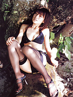 This saucey asian hottie seduces and allures in her stockings