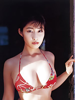 Incredible asian babe in a bikini shows off her big plump boobs