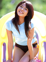 Adorably cute gravure idol babe in a blue t shirt and bikini