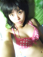 China teen girl in sexy pink colored polka dot bikini