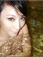 Chinese girlfriend with sexy eyes naked in the pool
