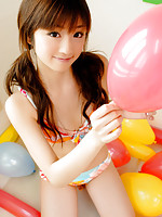 Petite gravure idol hottie is terribly cute in her bright bikini