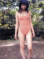 Adorably sweet asian beauty is terribly cute in a pink swim suit