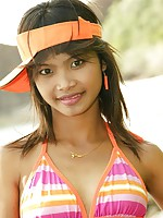 18 year old Thai teen in orange bikini at the beach