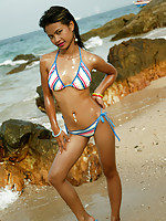 Adorable Thai teen model in bikini on the beach
