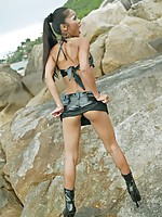 Thai babe Tailynn in latex on the beach