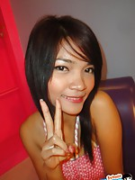Pretty Thai girlfriend poses before giving a blowjob
