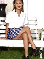 Asian girl in her checkered school girl skirt