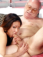 Old man giving an Asian girl a facial