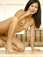 Here she is, fully naked and horny Asian chick waiting for you!