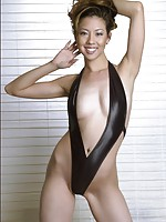 Seductive woman from Asian wearing only hot leather bikini