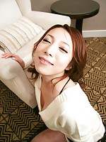 Kanako Tsuchiyo in lovely dress smiles as cum hits her face