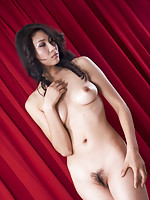 Tall Chinese model doing artistic nude pics