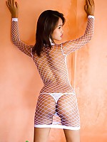 Porcelain Asian girl in sexy white net lingerie