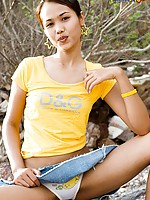 Asian in short denim skirt drops her panties