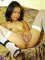 This petite hooker flashes her brown love orifices in the whorehouse where she is working