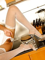 Cute Nicha in kitchen striptease