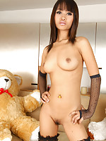 Thai babe Bua nude in stockings