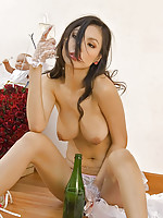 Busty Thai Miko sipping champagne