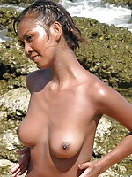 Thai talent Zyar nude on the rocks