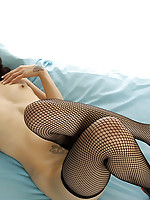 Yukie in fishnet stockings