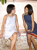 Two very cute teenage Asian lesbians doing it outdoors at night
