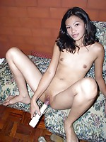 Young Filipina toying her horny shaved fanny with a big vibrator