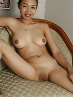 Escort girl flashing her shaved vertical smile in a luxurious Bangkok