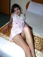 Gorgeous girl stripping in a love hotel to flash her hairy muff