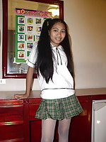 Long haired petite 18 yo  girl lifting her school skirt to show her privates