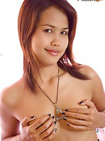 Tiny Thai Lily strips out of her tiny tube top