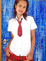 Lily Koh in sexy Asian schoolgirl uniform strips