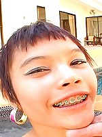 Little Thai teen with braces named Meme takes a big cock and creampie