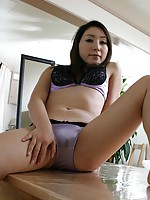 Japanese MILF Riho Natori spreads her legs to expose her wet pussy for fucking.