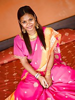 Brown Asha Kumara takes off beautiful India sari on bed