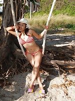 Fun Asian sweetheart Joon Mali in bikini swings outside