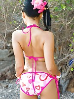 Heart bikini barely covers the booty of this Asian teen