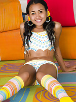 Petite brown Joon Mali shows her smooth shaved landing strip