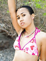 Thai bikini model Joon Mali flashes petite titties outside