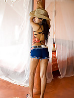 Cute Asian teen in cowboy hat slides down skimpy panties